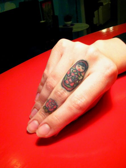 russian-doll-tattoo-finger